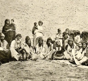 "Post-Card by Sarrafian brothers of Beirut of a group of Yezidis of Jabal [mountain] of Sinjar at the Iraqi-Syrian border. The Yezidi Kurds started settling in the mountain beginning in the 13th. century following the severe persecution by the Zengid Atabeg of Mosul, Badr al-Din Lulu. and later by the frequent Ottoman campaigns against the Sheikhan Yezidis north of Mosul. The mountain was a strong hold of the Nestorian Christians, who's Diocese ceased to exist after the 17th. century. The first of many campaigns by the Ottoman Turks, against the Yezidis of the Mountain, called by the Turks ""THE SACLI DAGH"", the mountain of the ""HAIRY ONE'S"", was carried by Melek Ahmad Pasha, the Vali of Diyarbekir [ 1640], the second by the Ottoman Firari Mustapha, the last occupation was in 1918, and directed against Hamu Sharu, the Sheikh of the Fuqara Yezidis, who refused to hand in the Christians refugees who sought shelter in the mountain from S.E.Turkey."