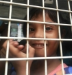 PAKISTANI CHRISTIAN CHILD HAPPY AND RELIEVED TO BE GETTING RELEASED. PHOTO: BPCA