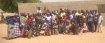 """""""WE ARE PRAYING FOR YOU IN AMERICA!"""" A GROUP OF NIGERIAN CHRISTIANS GATHERED TO WORSHIP THE LORD DESPITE THE HARDSHIPS AND ATROCITIES THEY FACE. PHOTO: VOICE OF THE PERSECUTED"""