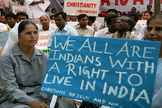 INDIAN CHRISTIANS HOLD PLACARDS AND BANNERS DURING A PROTEST IN NEW DELHI IN THIS FILE PHOTO TO DRAW ATTENTION TO CONTINUED ANTI-CHRISTIAN VIOLENCE. (PHOTO BY AFP